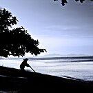 Woman Sweeping Beach by vanyahaheights
