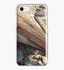 Wooden pole with an iron spike on the construction site iPhone Case/Skin