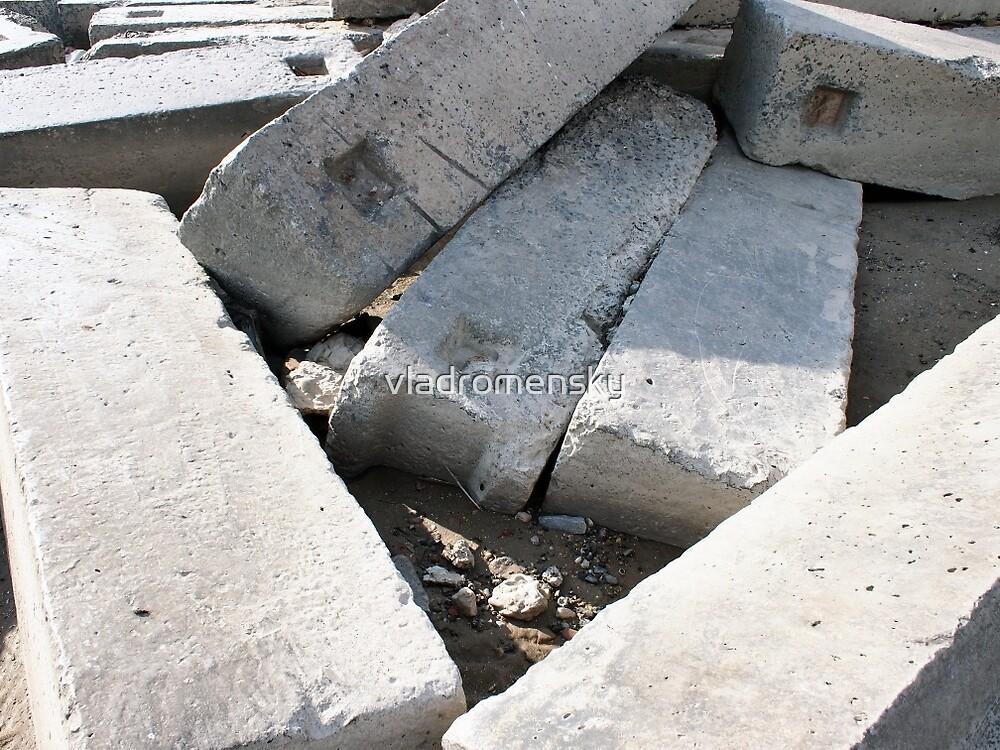 Large concrete building blocks closeup by vladromensky