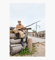 Retro style picture with soldier sitting on the bundles Photographic Print
