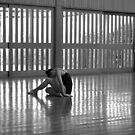 a dancer at the end of a long rehearsal day by Alfredo Estrella