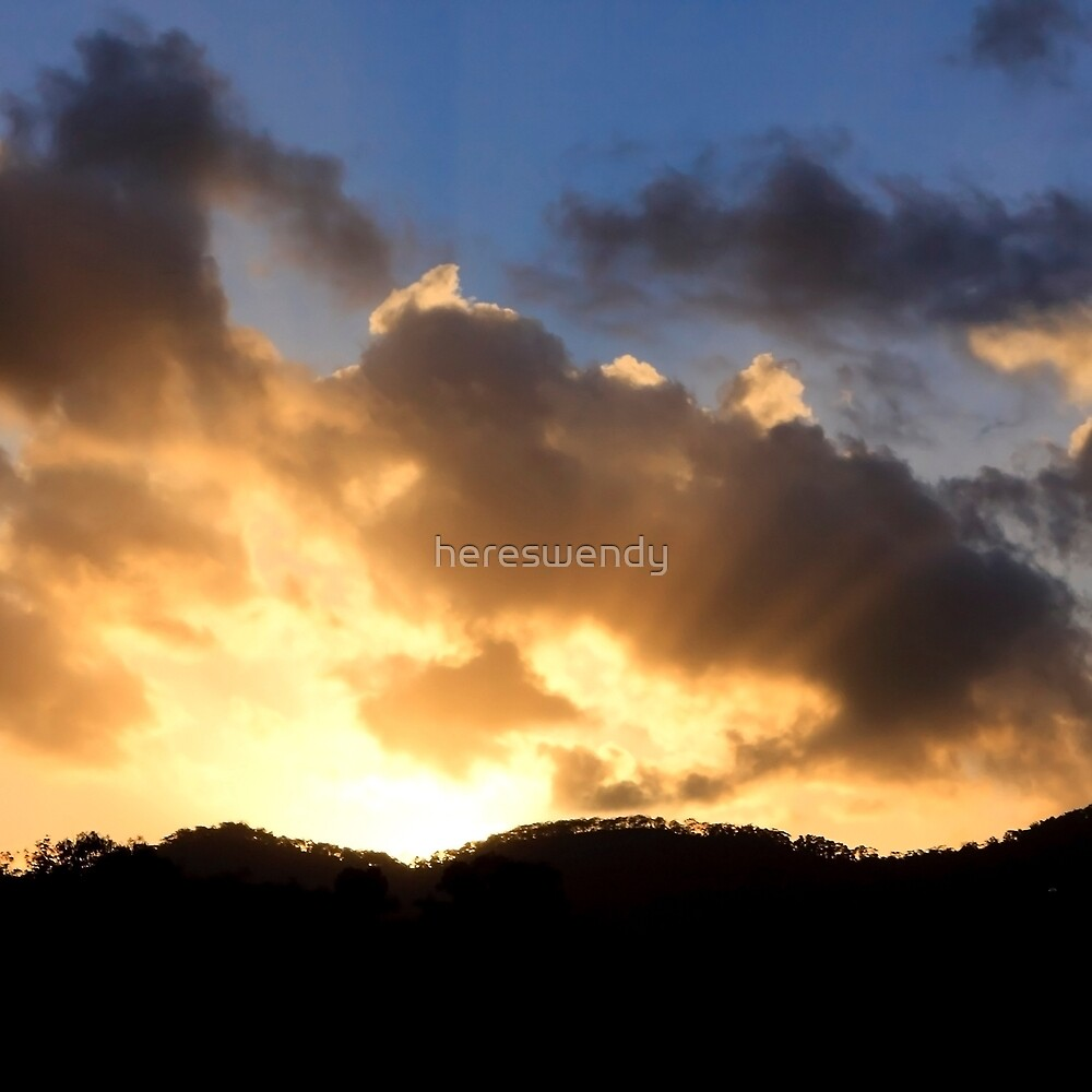 Sunrays peak through the clouds by hereswendy