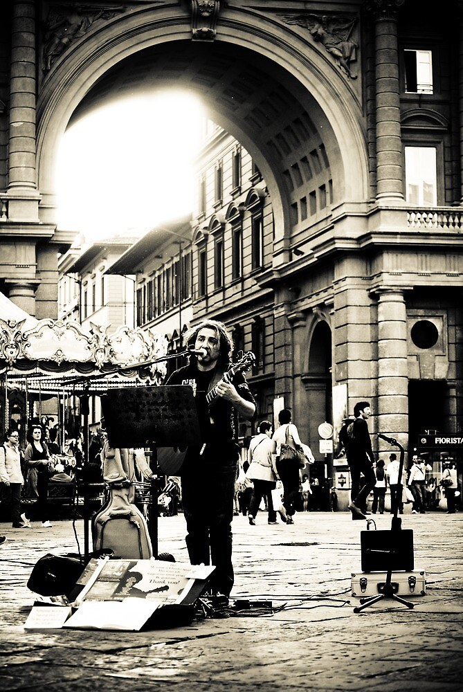 street artist brings music to the 'Piazza della Repubblica', city center of Florence by Neha Singh