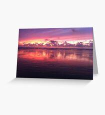 Firey reflective sunset in Manzanita, Oregon Greeting Card