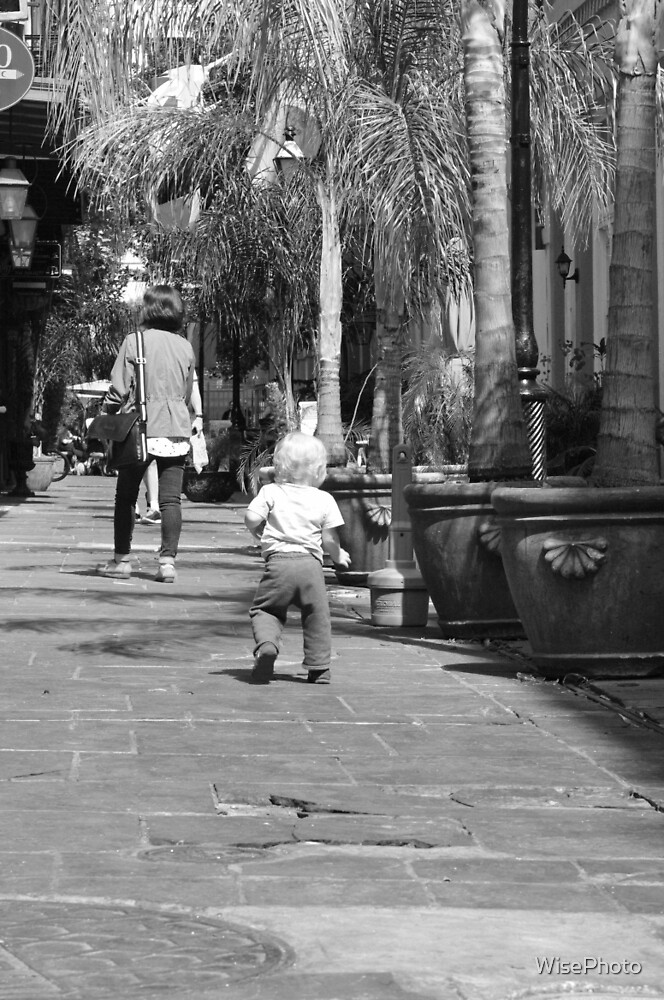 Toddler walking on Sidewalk by WisePhoto