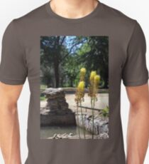 Selective focus on the yellow plants in the foreground Unisex T-Shirt