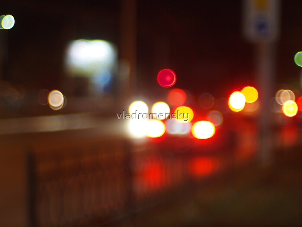 Blurred image of light from the glare of headlights by vladromensky