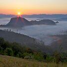 Sunrise over Thai-Myanmar border mountains by John Spies