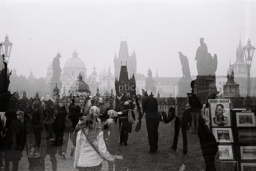 Time caught. Crossing over the Charles Bridge.  by ptica