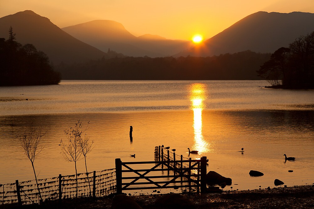 The Autumn Sun Sets on Derwent Lake, Keswick, Cumbria by Jan Fialkowski