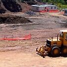 Earthmoving Equipment by Caterpillar by buildings