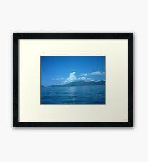 Cloud horse drifting over a island. Framed Print