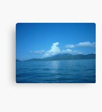Cloud horse drifting over a island. Canvas Print