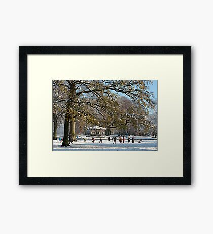 Snow fun under the tree Framed Print