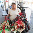 Selling Christmas crowns - Vendiendo Coronas, Puerto Vallarta, Mexico by PtoVallartaMex
