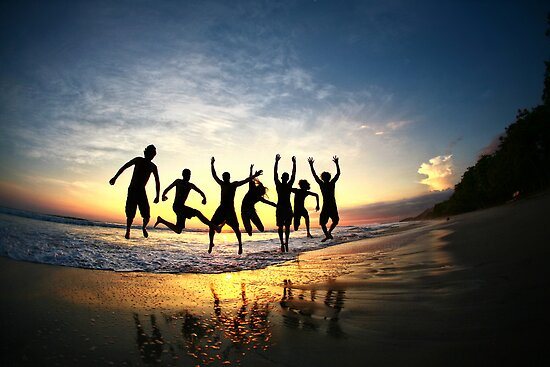 """Group of Friends Jumping on Beach at Sunset"" by ieatstars ..."
