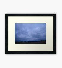 Storm clouds at dusk Framed Print
