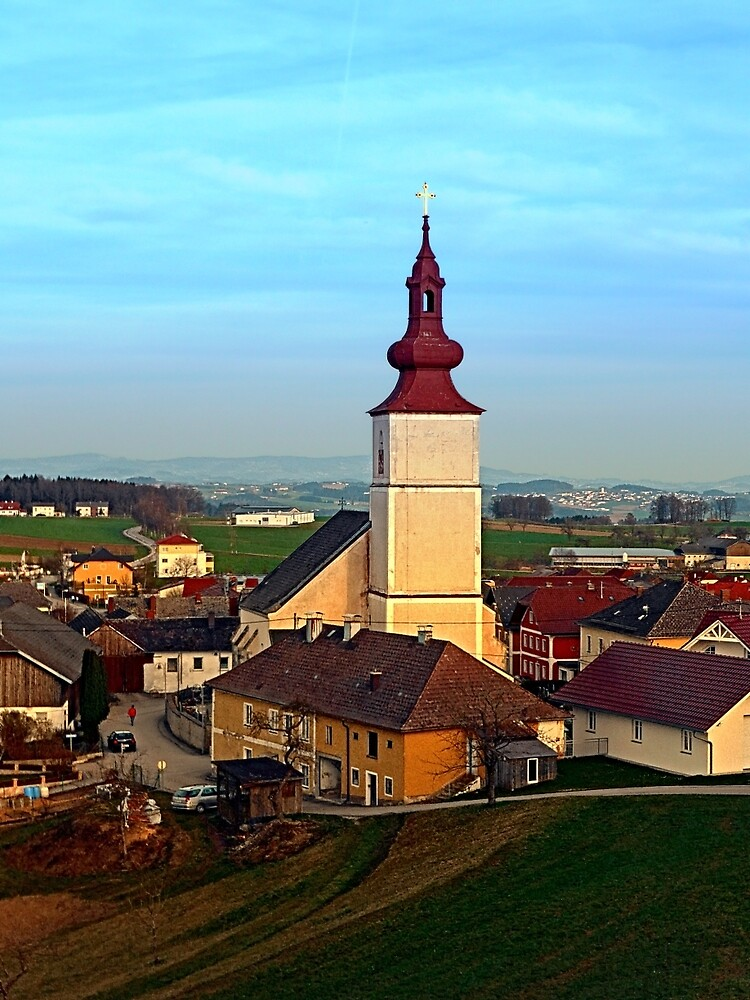 Village and church in warm sundown light | landscape photography by Patrick Jobst