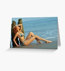 Pretty woman in blue bikini arching her back on a beach  Greeting Card