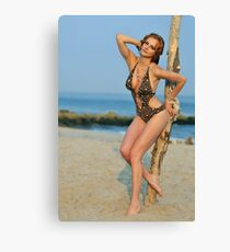 Young redhead girl on the beach standing pretty in designers swimsuit  Canvas Print