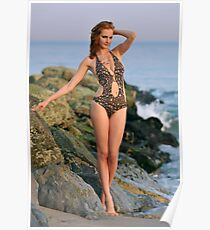 Young redhead girl on the beach standing pretty in designers swimsuit at rocky jetty Poster