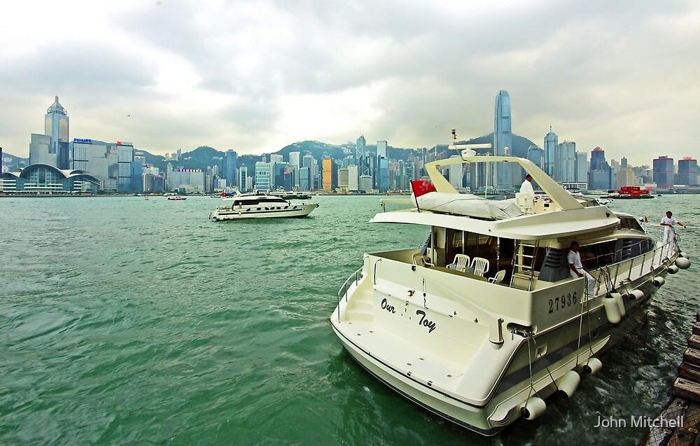 Victoria Harbor, Hong Kong. by John Mitchell