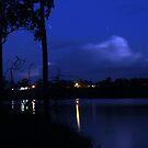 Distant storm over Burnett River. by Paul  Donaldson