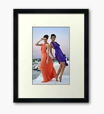 Two beautiful girls posing gorgeous on the deck of luxury yacht  Framed Print