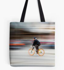 Cyclist in motion Tote Bag
