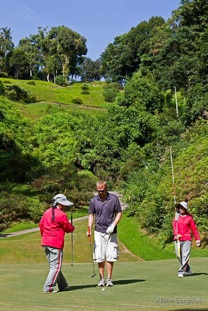 Zane at Red Mountain Golf Club with the two caddies, Phuket, Thailand by Alison Simpson
