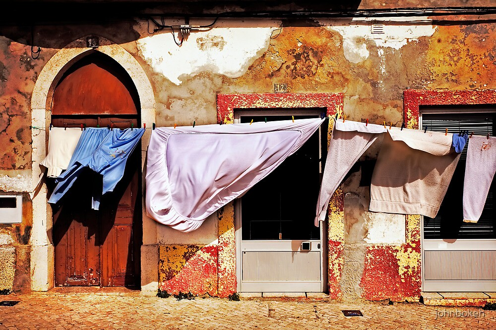 laundry hanging in front of the house by johnbokeh