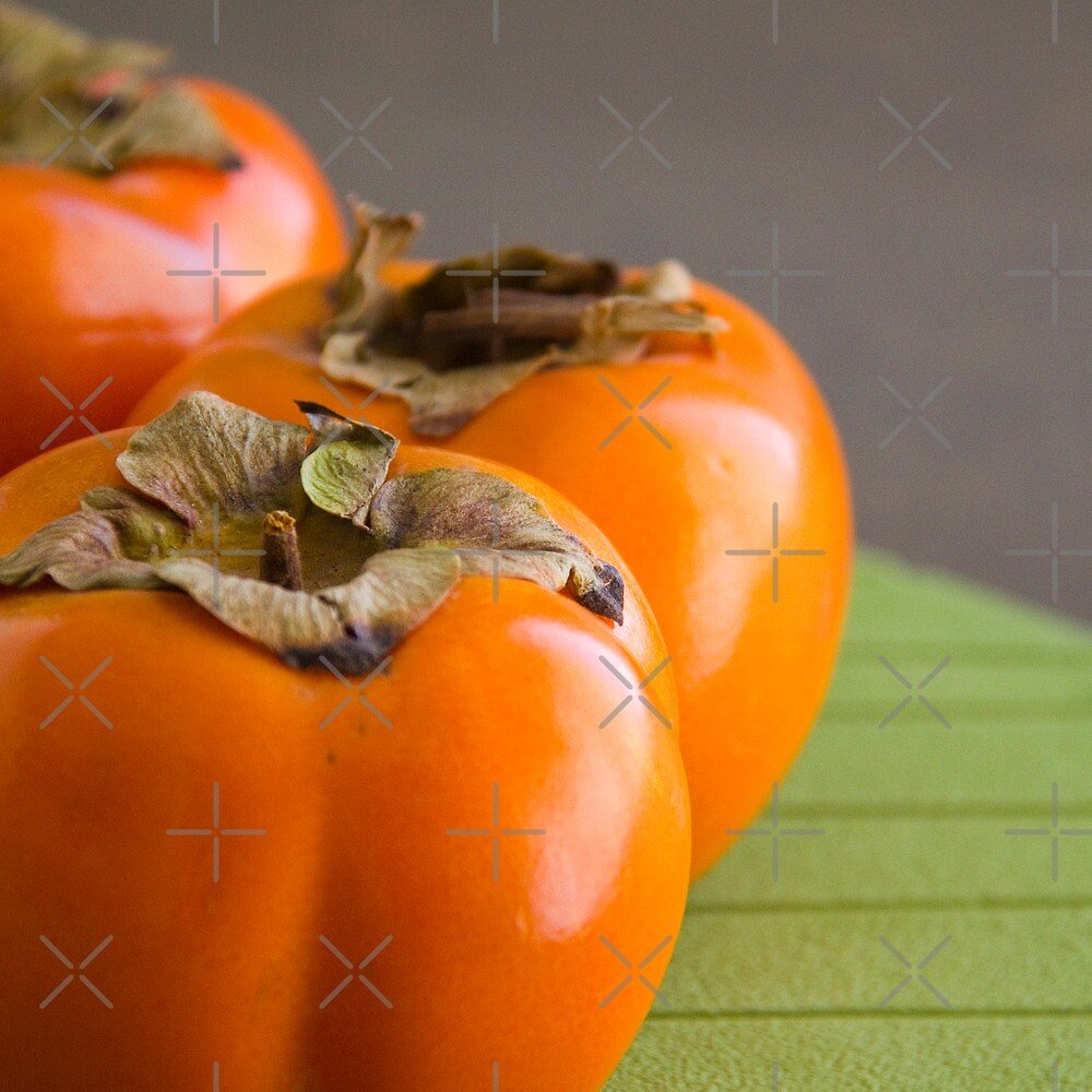 Rape Persimmons on the table by Margarita K