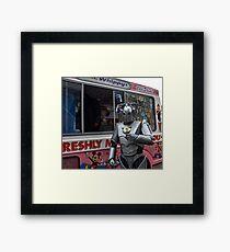 Cyberman with ice cream Framed Print