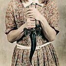 Female holding a curved knife by Sharonroseart