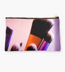 Several makeup brushes. Multicolored Studio Pouch