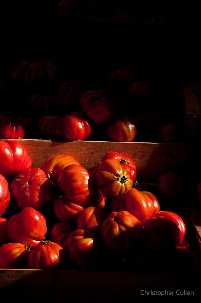 Tomatoes in a market stall by Christopher Cullen