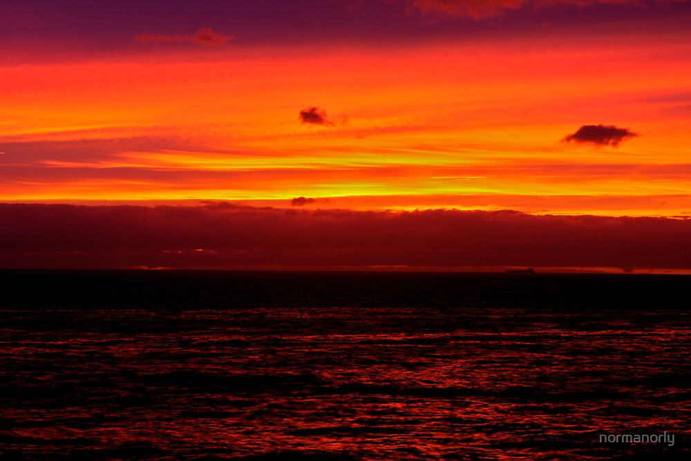 FIRE BY THE SEA by normanorly
