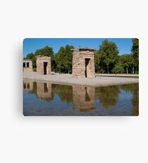 Egyptian temple in Madrid is reflected in surrounding transparent water Canvas Print