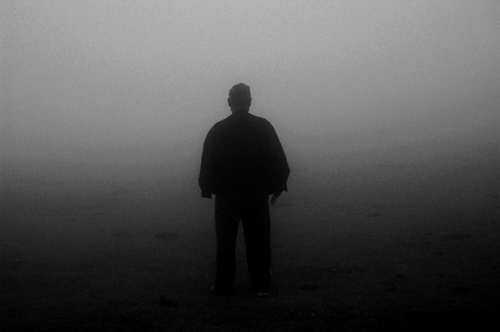 Man standing in the fog by alanbuech