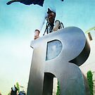 Handstand over the 'R' of Barcelona  by Wari Om  Yoga Photography