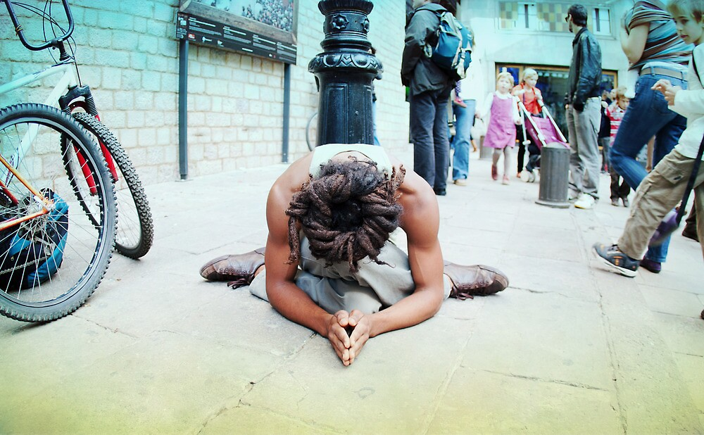 Humble meditation in the streets of Barcelona by Wari Om  Yoga Photography