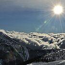 soleil sur mer de nuages by Rebattu Etienne