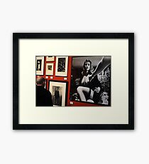 Unknown man looking at Art work of Helmut Newton worth $125.000 Framed Print