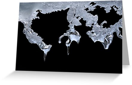 World map carving on icicles in cold light  by Anton Oparin