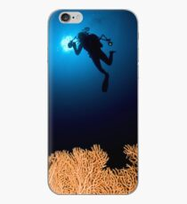 Underwater photograph of a diver swimming above an Anella Alcyonacea (soft corals) coral iPhone Case