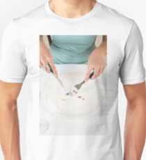 Diet concept - female Teen eats vitamins and pills with a fork and knife, instead of food  Unisex T-Shirt