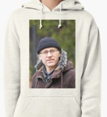 Portrait of man in light of the natural Pullover Hoodie