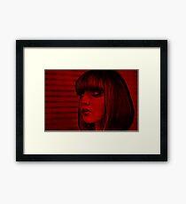 Red doll Framed Print