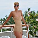 Model posing at the rooftop of Tides hotel for Norma Kamali Collection by Anton Oparin
