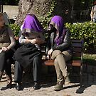 People in Istanbul - Sharing a shawl by Marjolein Katsma